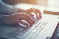 Woman writing a blog.